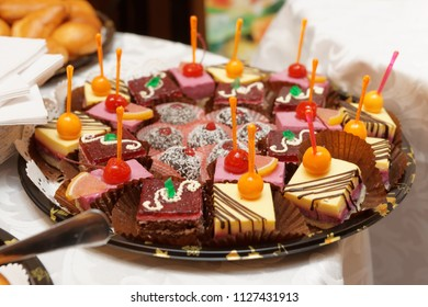 Variation of inexpensive desserts on catering table