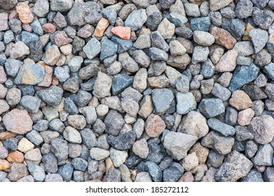 Varicolored gravel stone texture with small details