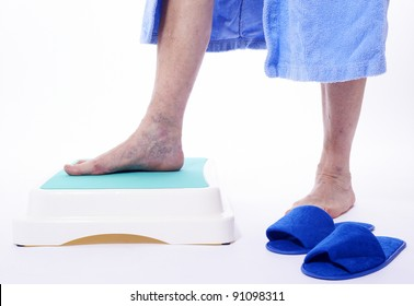 Varicose veins closeup, foot on modular bath step, image isolated on white background