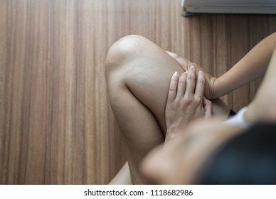 Varicose veins on the womans leg,Normal veins near the skin layer swell out,And blood is accumulated to see a bloody blue or dark purple