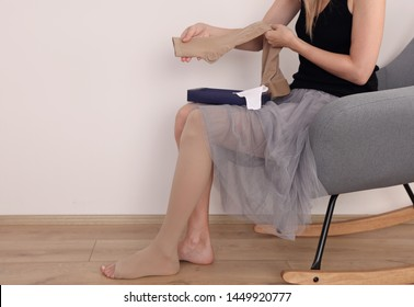 Varicose veins prevention, Compression tights, relief for tired legs. Beautiful female legs in stockings