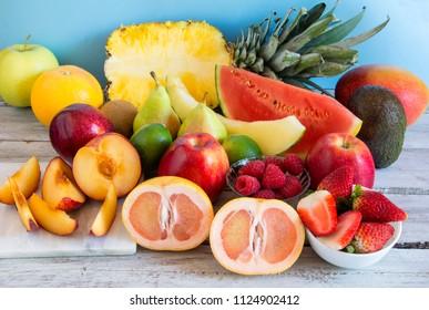 Varied fresh fruit on a wooden board