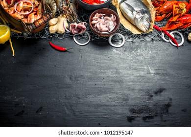 Varied fresh seafood. On the black chalkboard.