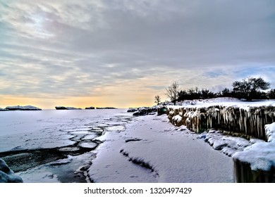 Varied layers of the frozen Lake Michigan after the polar vortex winter storm in the Chicago land area, Midwestern United States, on the coast of Illinois State Beach during the day.