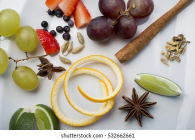 varied spices and fruits for gin tonics on white  background