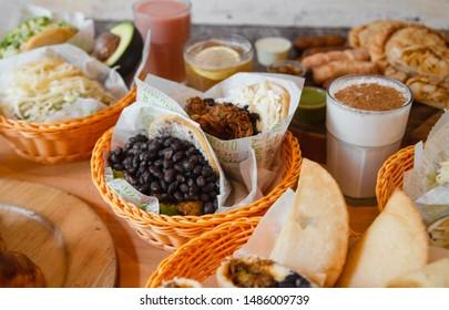 Varied of typical Venezuelan food, arepas, tequeños and milkshakes