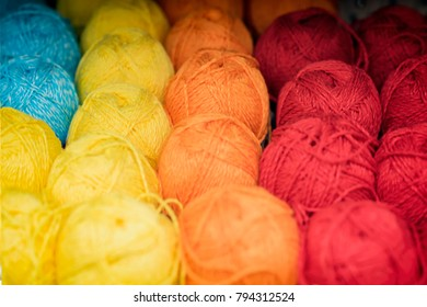 Variegated and bright multicolored fluffy yarn for knitting. Store of goods for creativity and needlework. Hobby, needlework