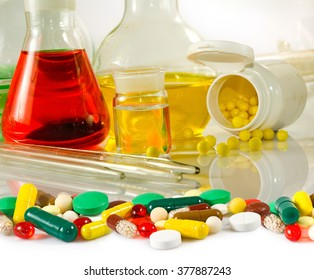 varies glassware laboratory and pills closeup
