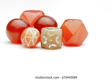Varieties of ancient carnelian beads on white background