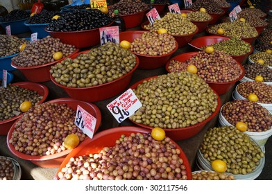 varieties of olives in the basins on the market