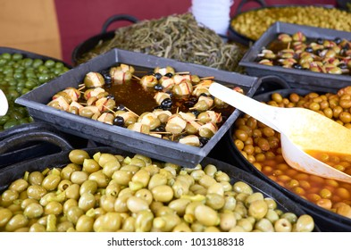 Varieties of olives in a market