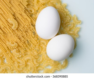varieties of pasta with a couple of eggs