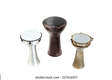"""Varieties of percussion musical instrument call 'Turkish Tomolo', """"Darbuka"""" and """"Yenki"""" on white background. The instruments are also known as goblet drum and beat with fingertip."""