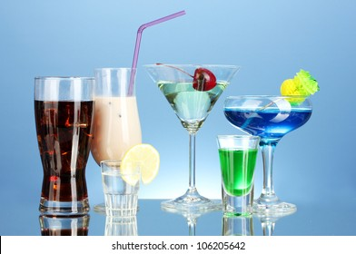 a variety of alcoholic drinks on blue background