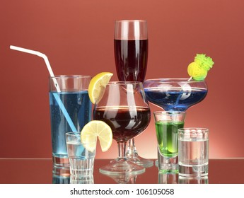 a variety of alcoholic drinks on red background