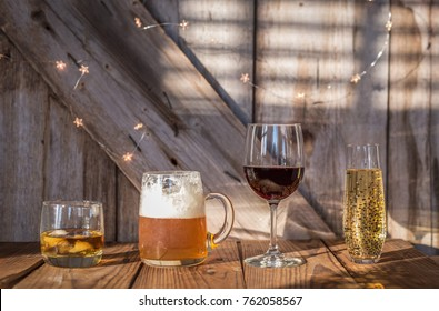 variety of alcoholic drinks on rustic wood background