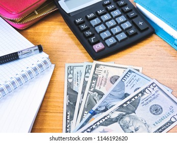 Variety of American money laid out under a stack of cash.Hundred US dollar bills. Selective focus.Background with money american.Bisiness finance concept.Dollars Closeup Concept.