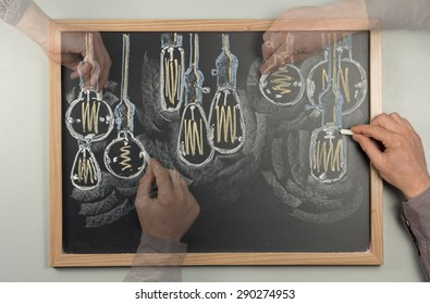 Variety of antique edison style lightbulbs drawn on chalkboard