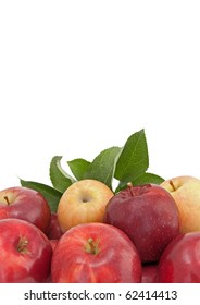 Variety of apples with green leaves, isolated on white background.