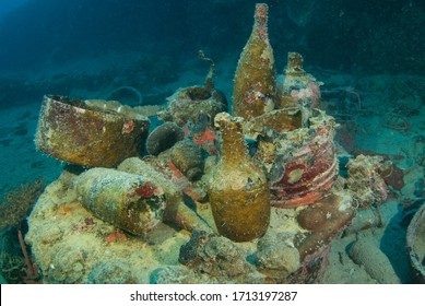 A variety of artifacts that can be discovered by scuba divers in a sunken ship. The vessel that held this cargo was a second world war Japanese ship that was sunk in Chuuk Lagoon during conflict
