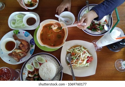 Variety authentic Thai foods like somtam, seafood tomyam, shredded meat, spicy fried chicken and a various drinks. Flat lay concept.