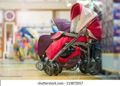 Variety of baby carriages in kids mall