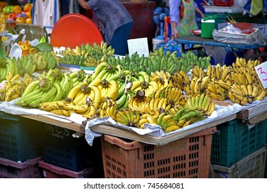 variety of bananas are ready to eat keep lined up for customers to shop in the evening market