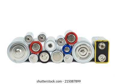 Variety of batteries viewed from the front, isolated on white background