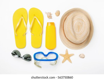 1674808e4 Variety beach accessories on white background. Vacation and travel items
