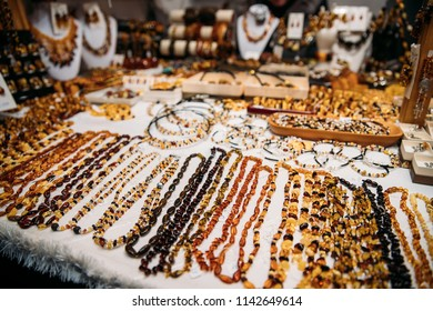 Variety Of Beads Made Of Amber. Jewellery Made Of Amber. Traditional Souvenirs At European Market. Souvenir From Baltic Countries, Europe.