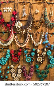 Variety of Beautiful Creative Shine Colorful Stone Plastic Jewellery Necklaces Hanging on The Wall for Sale in The Market, Handmade Stone Plastic Fashion Accessoriesfor Woman