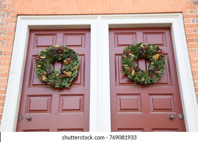 A variety of beautiful wreaths displayed for the Christmas season.