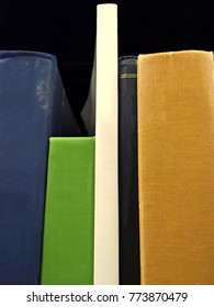 Variety of blank book spines on a bookshelf