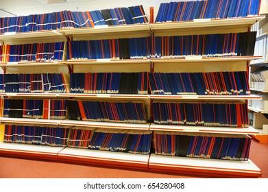 Variety books on rack.