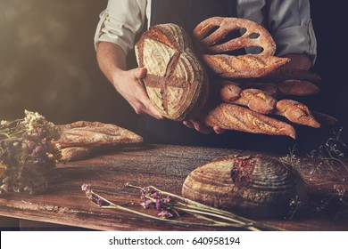 Variety of bread hold men's hands