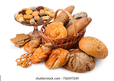 Variety bread products (buns, bread, biscuits, crackers) isolated on white background. Large assortment bread baking with clipping path. Top view.