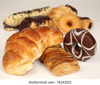 Variety of cakes. Donuts and croissant