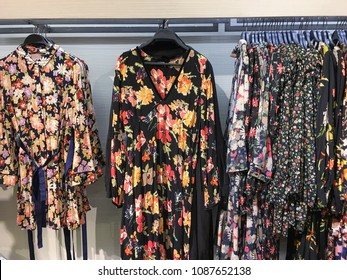 Variety of casual different female, floral,sundress clothes hanging