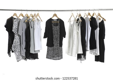 Variety of casual fashion clothing hanging on hangers