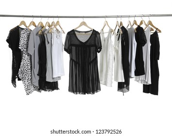 Variety of casual fashion clothing on hangers and boots