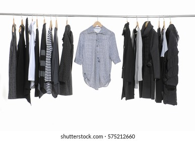Variety of casual female clothing hanging on hangers