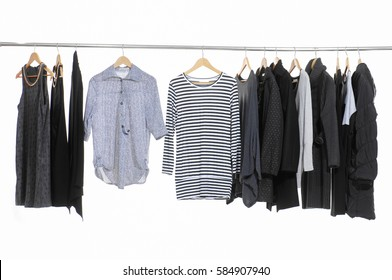 Variety of casual female clothing,sundress, coat, hanging on hangers