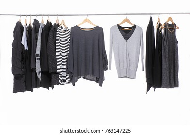 Variety of casual female colorful clothing hanging on hangers-white background