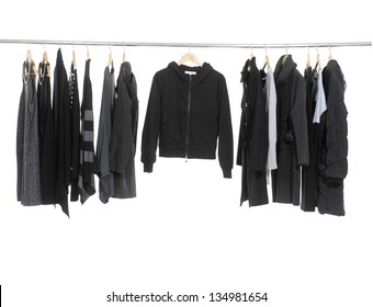 Variety of casual female fashion clothing hanging on hangers