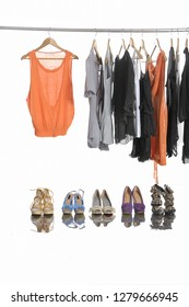 Variety of casual female shirt, ,sundress clothes hanging with shoe