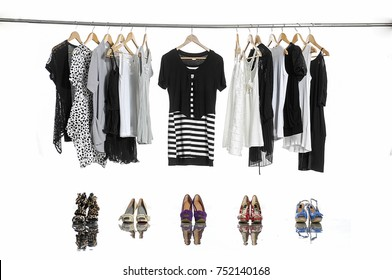 Variety of casual female shirt,coat ,sundress clothes hanging with shoes