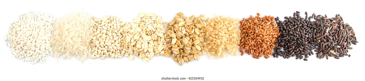 Variety cereal grains over wooden background