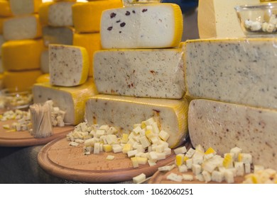 Variety of cheese on the store counter. Food