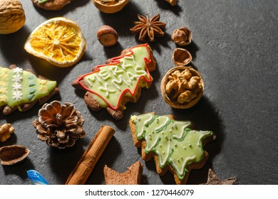 variety of christmas food products ginger cake nuts cinnamon stick lollipop