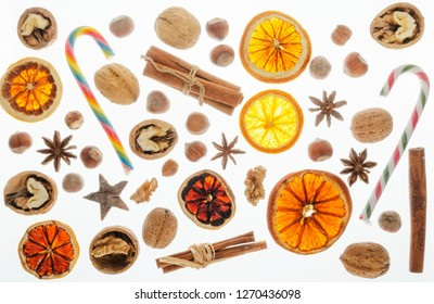 variety of christmas food products nuts cinnamon stick lollipop orange slice isolated on white background